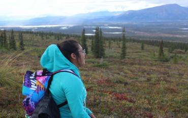 Stephanie Carrasco (Compton, CA) takes in the view from a ridge along the edge of the Arctic National Wildlife Refuge during the 2016 Fresh Tracks Leadership Expedition